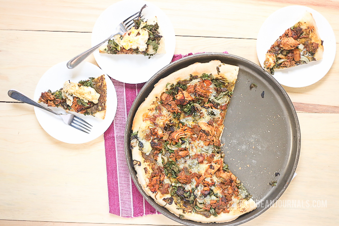 Pesto Chicken Pizza with caramelized onions and loads of cheese! | Jellibeanjournals.com